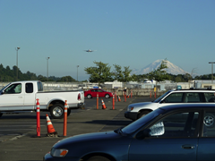 Cargo plane on approach, Mount Rainer in background
